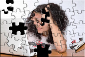 Puzzle image of person at laptop